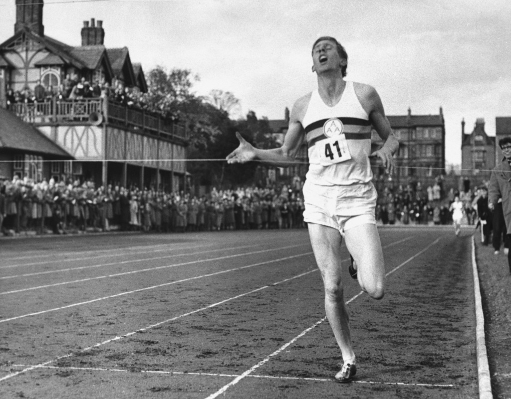FILE - In this May 6, 1954, file photo, British athlete Roger Bannister breaks the tape to become the first man ever to break the four minute barrier ...