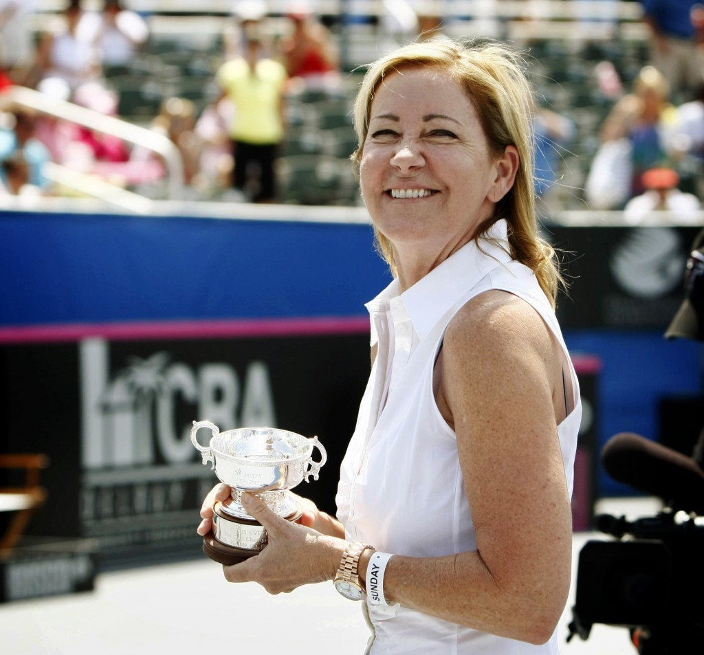 FILE - In this April 21, 2013, file photo, tennis great Chris Evert accepts a replica trophy to honor her Fed Cup achievements as a member of the Unit...