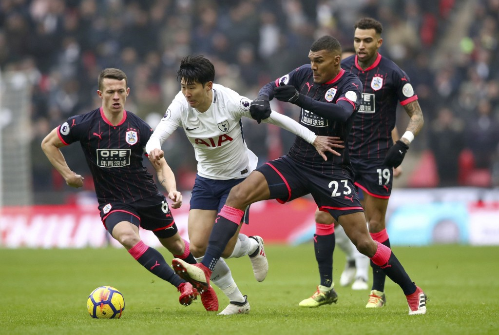 Tottenham Hotspur's Son Heung-Min, centre, and Huddersfield Town's Collin Quaner, centre right, in action during their English Premier League soccer m...