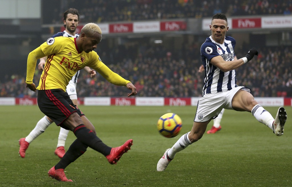 Watford's Andre Carrillo, left, attempts a shot against West Bromwich Albion during their English Premier League soccer match at Vicarage Road in Watf...