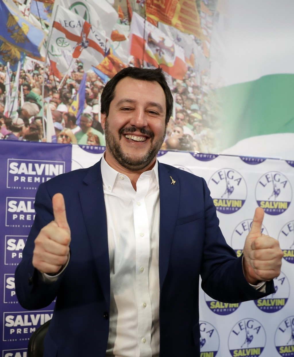 Right-wing, anti-immigrant and euroskeptic League's Matteo Salvini gives the thumbs up at the end of a press conference on the preliminary election re...