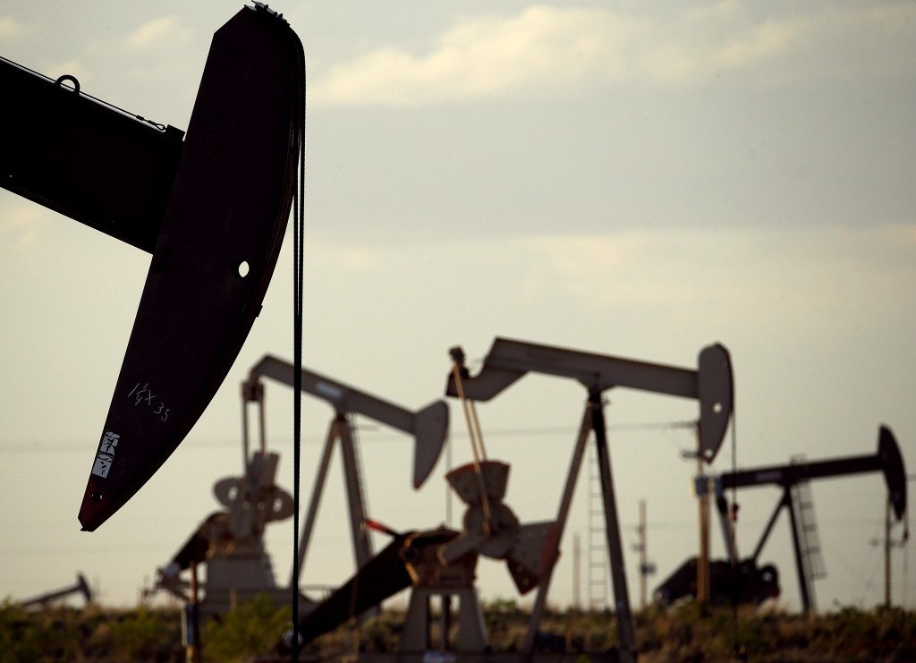 FILE - In this April 24, 2015 file photo, pumpjacks work in a field near Lovington, N.M. The boom in US oil production is expected to satisfy most of ...
