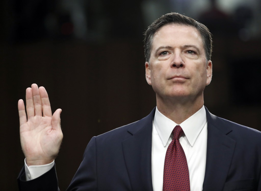 FILE - In this June 8, 2017 file photo, former FBI Director James Comey is sworn in during a Senate Intelligence Committee hearing on Capitol Hill in