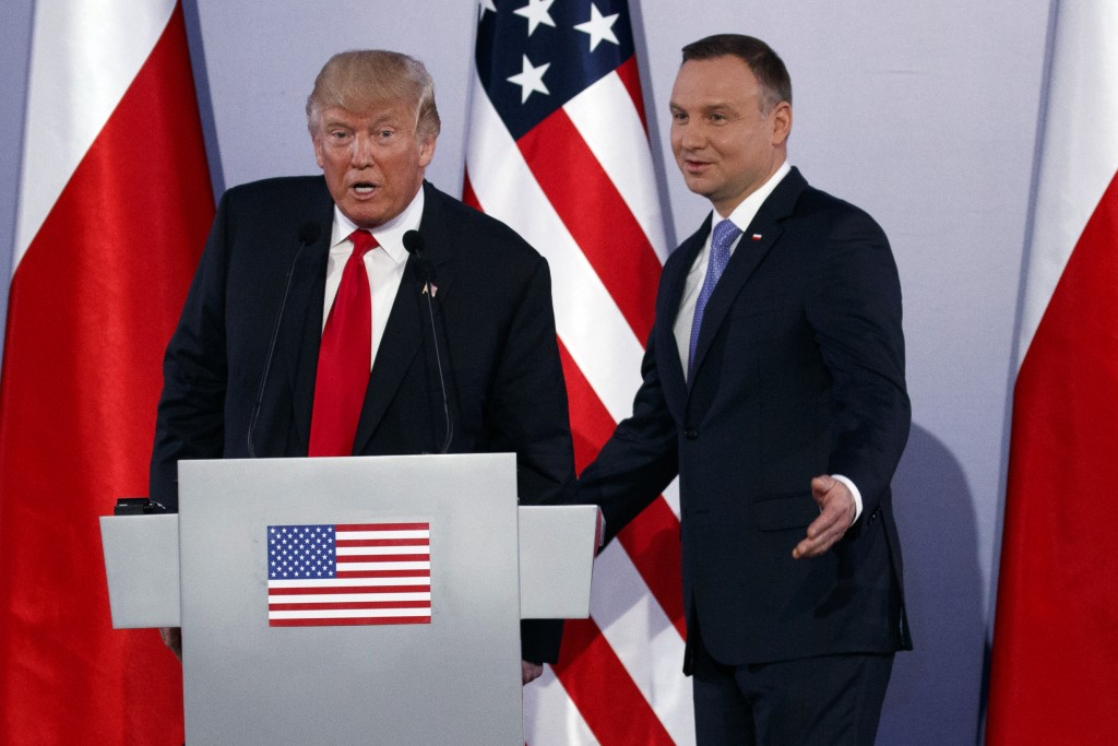 FILE - In this file photo dated Thursday July 6, 2017, Poland's President Andrzej Duda, right, and U.S President Donald Trump attend a news conference