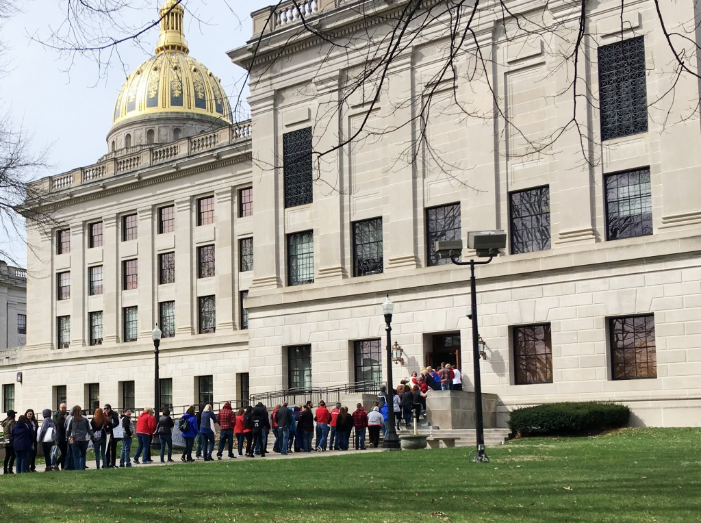 Striking West Virginia teachers line up to enter the state Capitol on Monday, March 5, 2018, in Charleston, W.Va. Teachers are waiting for state lawma...