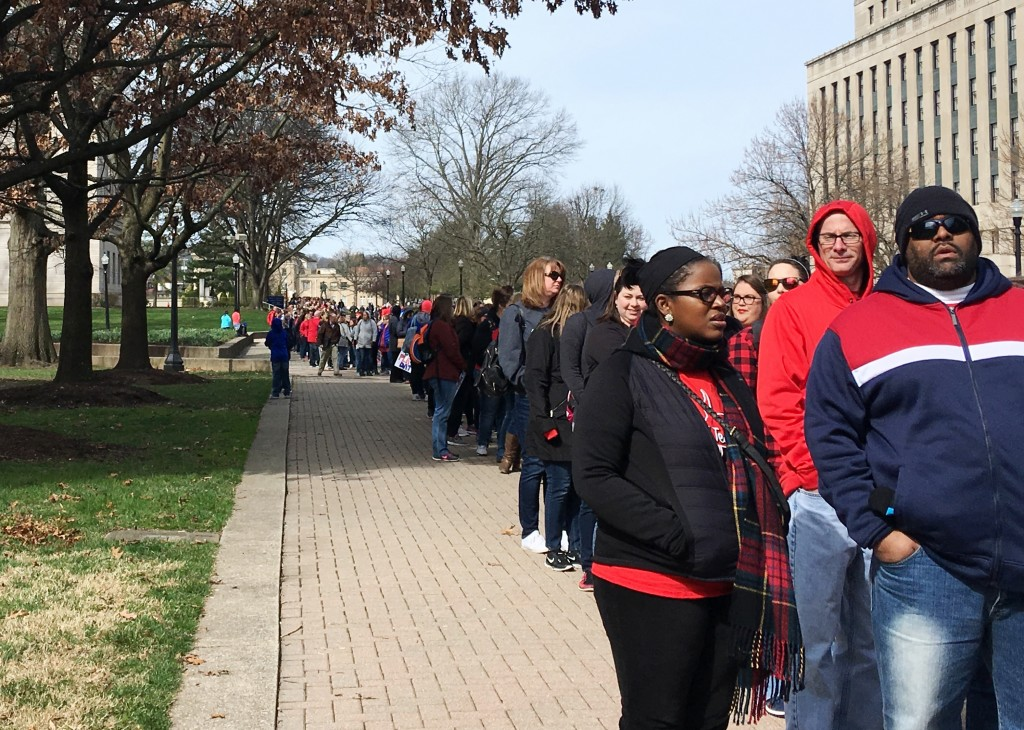 Striking West Virginia teachers line up Monday, March 5, 2018, to enter the state Capitol in Charleston, W.Va. Teachers are waiting for state lawmaker...