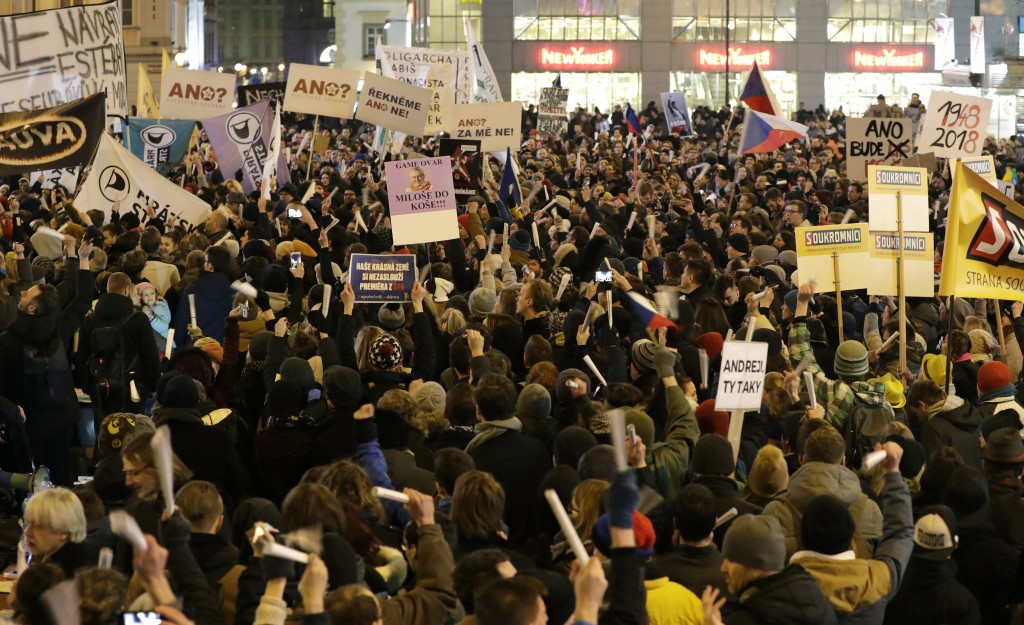Protesters gather for a demonstration downtown Prague, Czech Republic, Monday, March 5, 2018. Thousands of Czechs are rallying in the capital and othe...