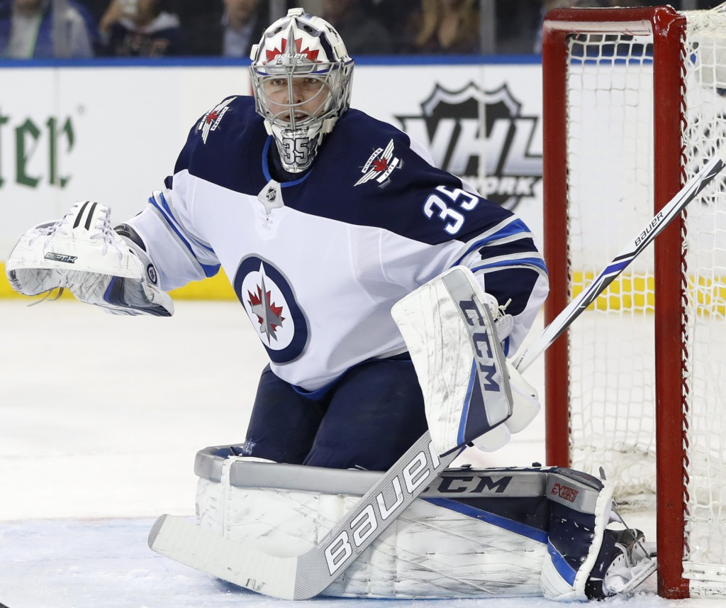 Winnipeg Jets goaltender Steve Mason (35) works in the net during the second period of an NHL hockey game against the New York Rangers in New York, Tu