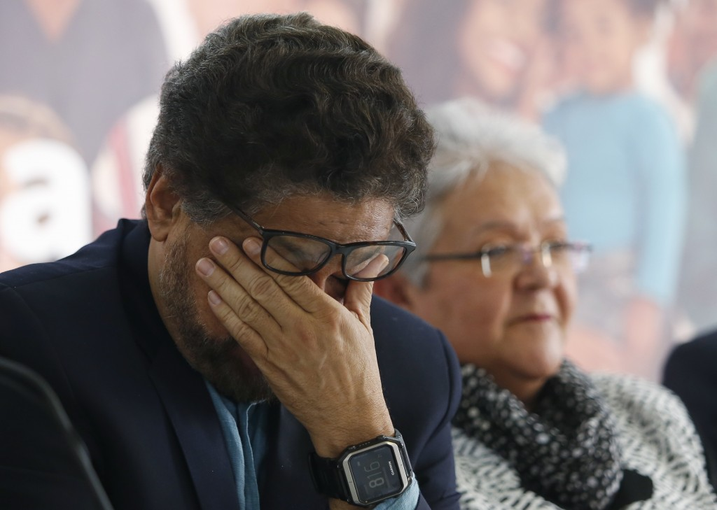 Ivan Marquez, a former leader of the Revolutionary Armed Forces of Colombia, FARC, wipes his eyes as he announces the withdrawal of former guerrilla c