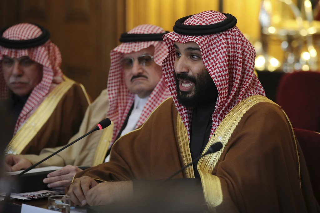 Saudi Crown Prince Mohammed bin Salman conducts a meeting with Britain's Prime Minister Theresa May with other members of their delegations, inside 10