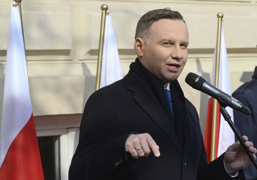 Polish President Andrzej Duda speaks during ceremonies marking the 50th anniversary of student protests that were exploited by the communists to purge