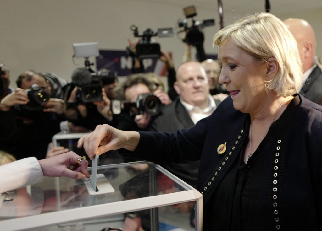 French far-right presidential candidate, Marine Le Pen casts her vote, in Lille, northern France, Saturday, March 10, 2018. Marine Le Pen will propose