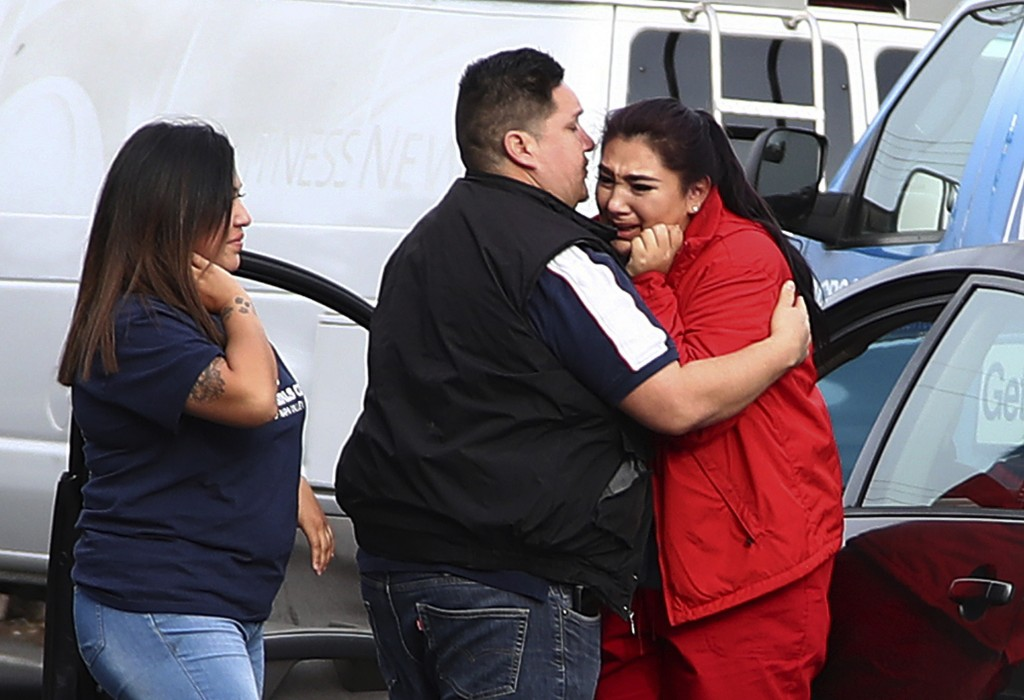 Fernando Juarez, 36, of Napa, center, embraces his 22-year-old sister Vanessa Flores, right, at the Veterans Home of California on Friday March 9, 201