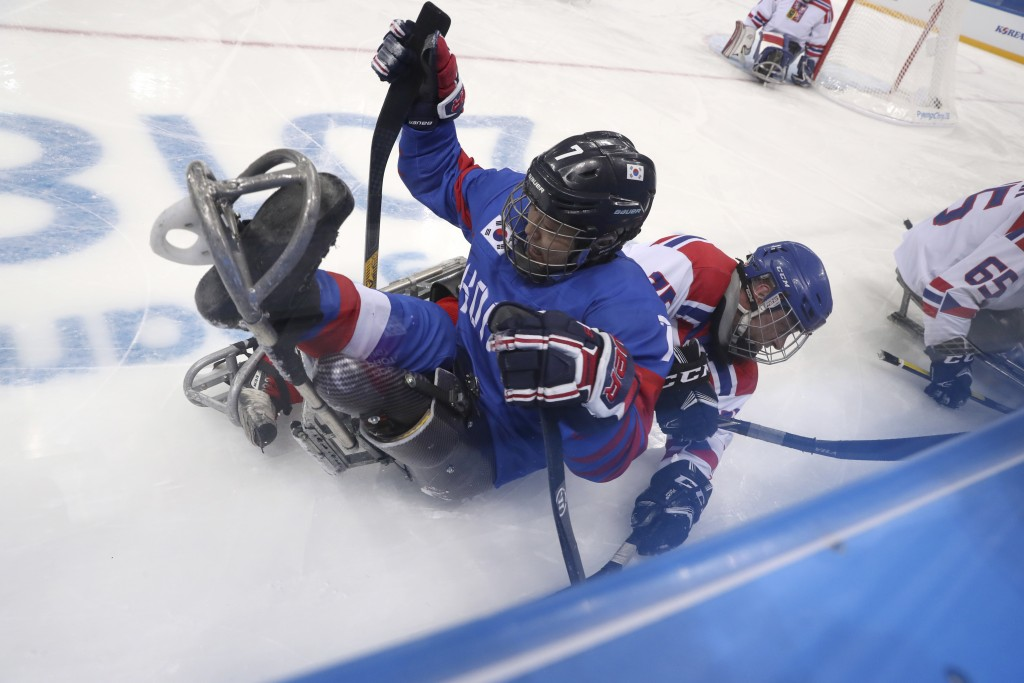 Czech Republic's Jiri Raul collide with South Korea's Choi Kwang Hyouk during a preliminary Ice Hockey match of the 2018 Winter Paralympics held in Gu...