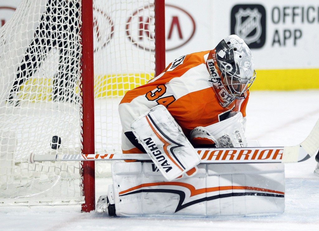 The goal by Winnipeg Jets' Patrik Laine is in the net behind Philadelphia Flyers goalie Petr Mrazek during the third period of an NHL hockey game Satu...