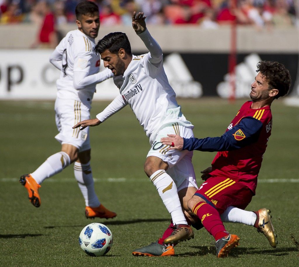 Real Salt Lake midfielder Kyle Beckerman, right, trips up Los Angeles FC forward Carlos Vela (10) during an MLS soccer match at Rio Tinto Stadium in S