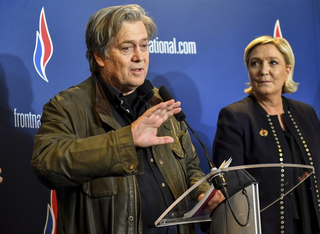 Former White House strategist Steve Bannon holds a press conference with National Front party leader Marine Le Pen, right, at the party congress in th