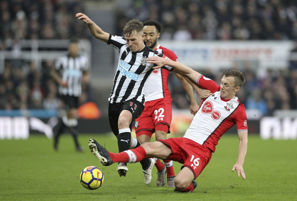 Newcastle United's Matt Ritchie, left, clashes with Southampton's James Ward-Prowse during their English Premier League soccer match at St James' Park