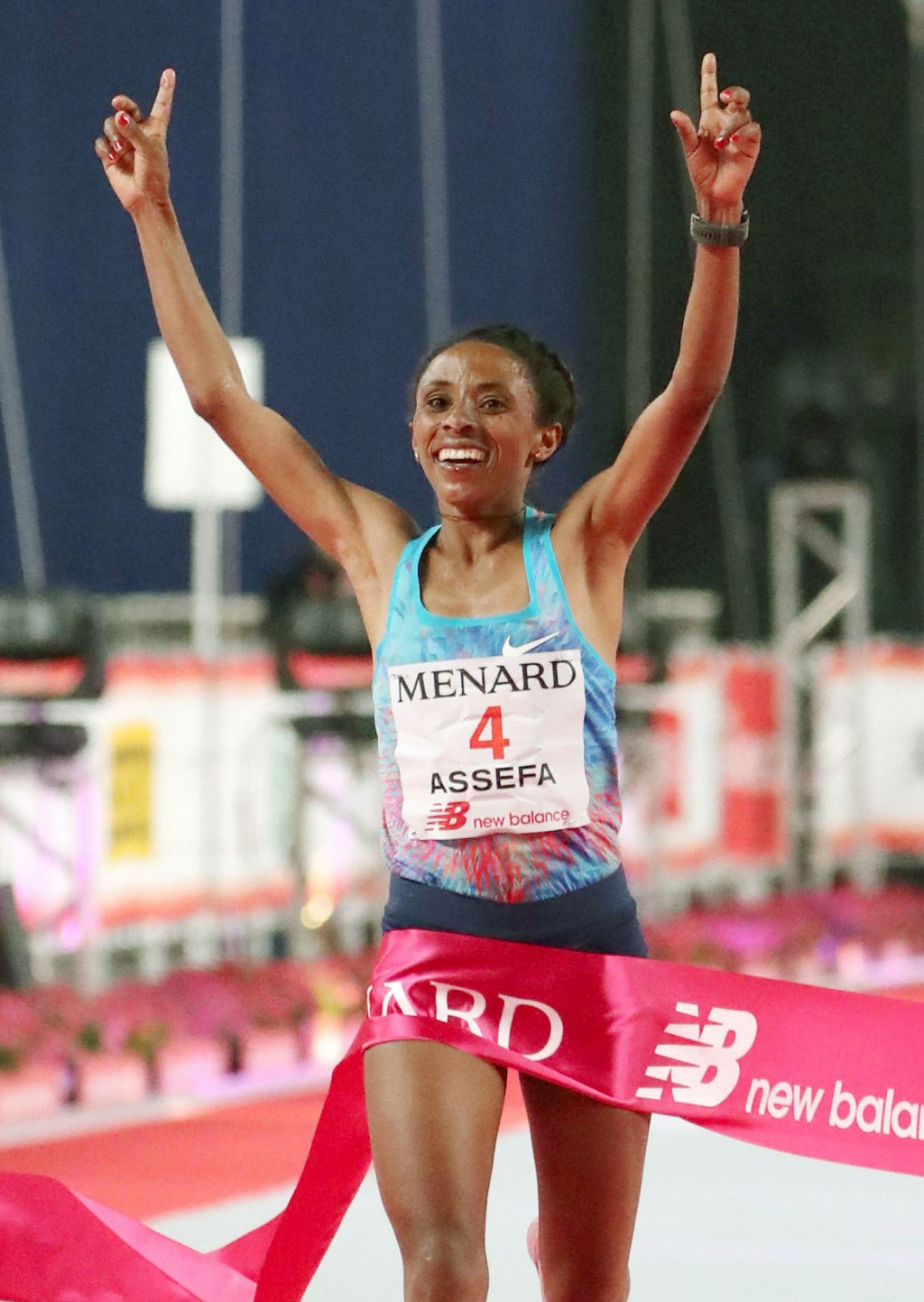 Meskerem Assefa of Ethiopia crosses the finish line, winning Nagoya Women's Marathon in Nagoya, central Japan, Sunday, March 11, 2018.  Assefa won wit