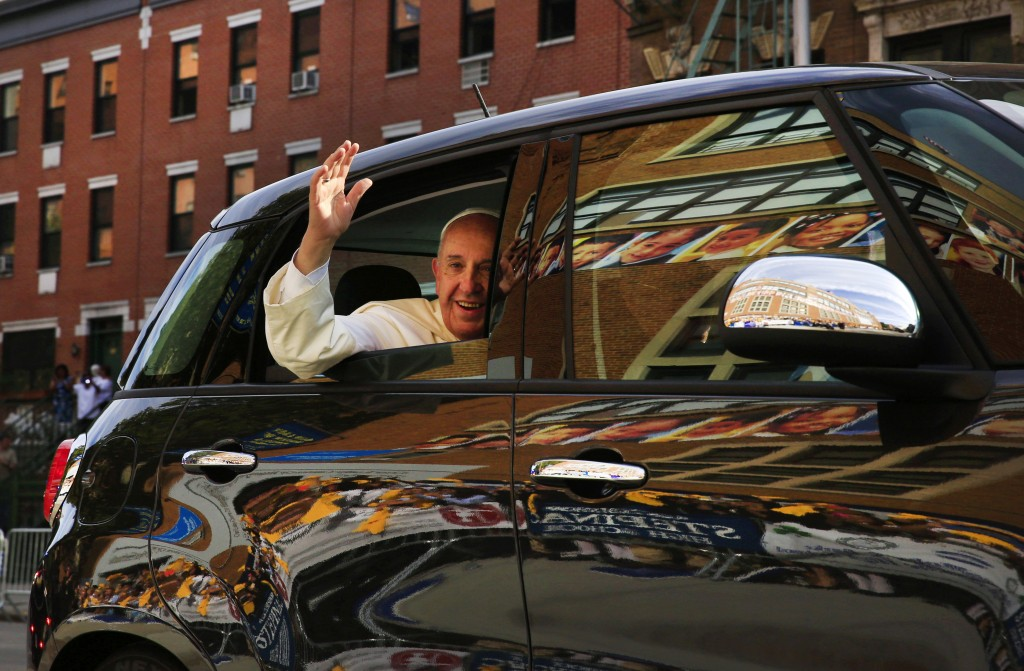 FILE - In this Sept. 25, 2015 file photo, Pope Francis arrives in his car for a visit to Our Lady Queen of Angels School in the Harlem neighborhood of