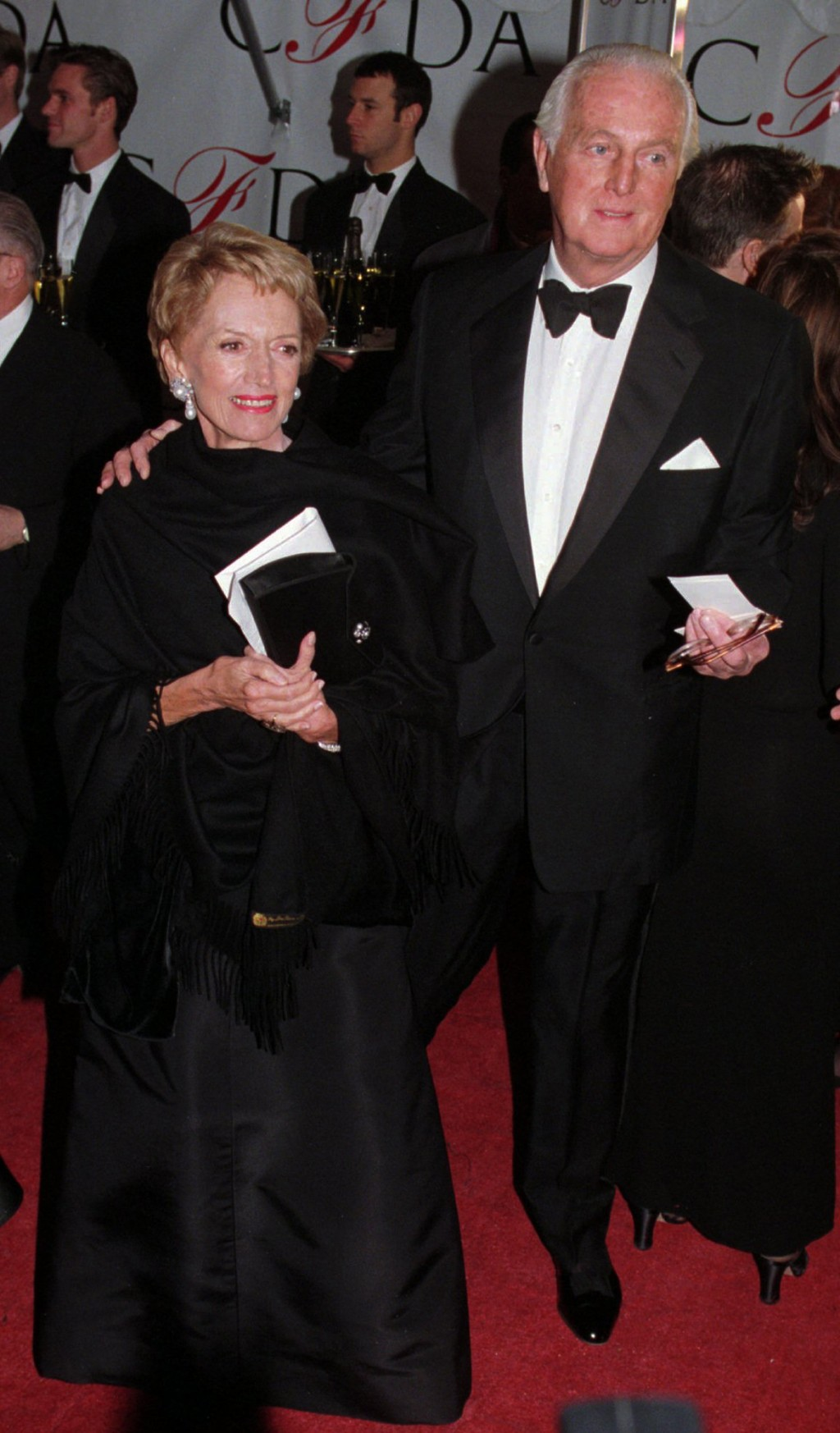 FILE - In this Feb.12 1996 file photo, Hubert de Givenchy arrives with his wife, Mary, at the Council of Fashion Designers of America 1996 Awards Gala