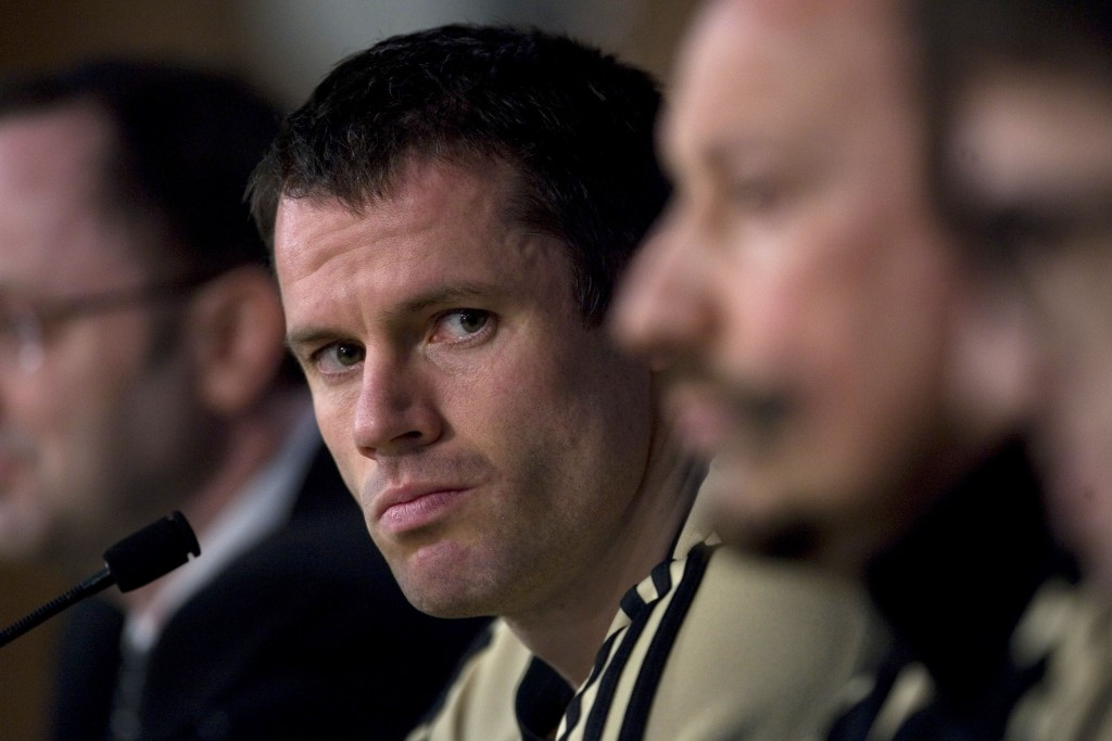 FILE - This is a Tuesday, Feb. 24, 2009 file photo of  Liverpool's Jamie Carragher as he listens to a question during a press conference ahead of a Ch