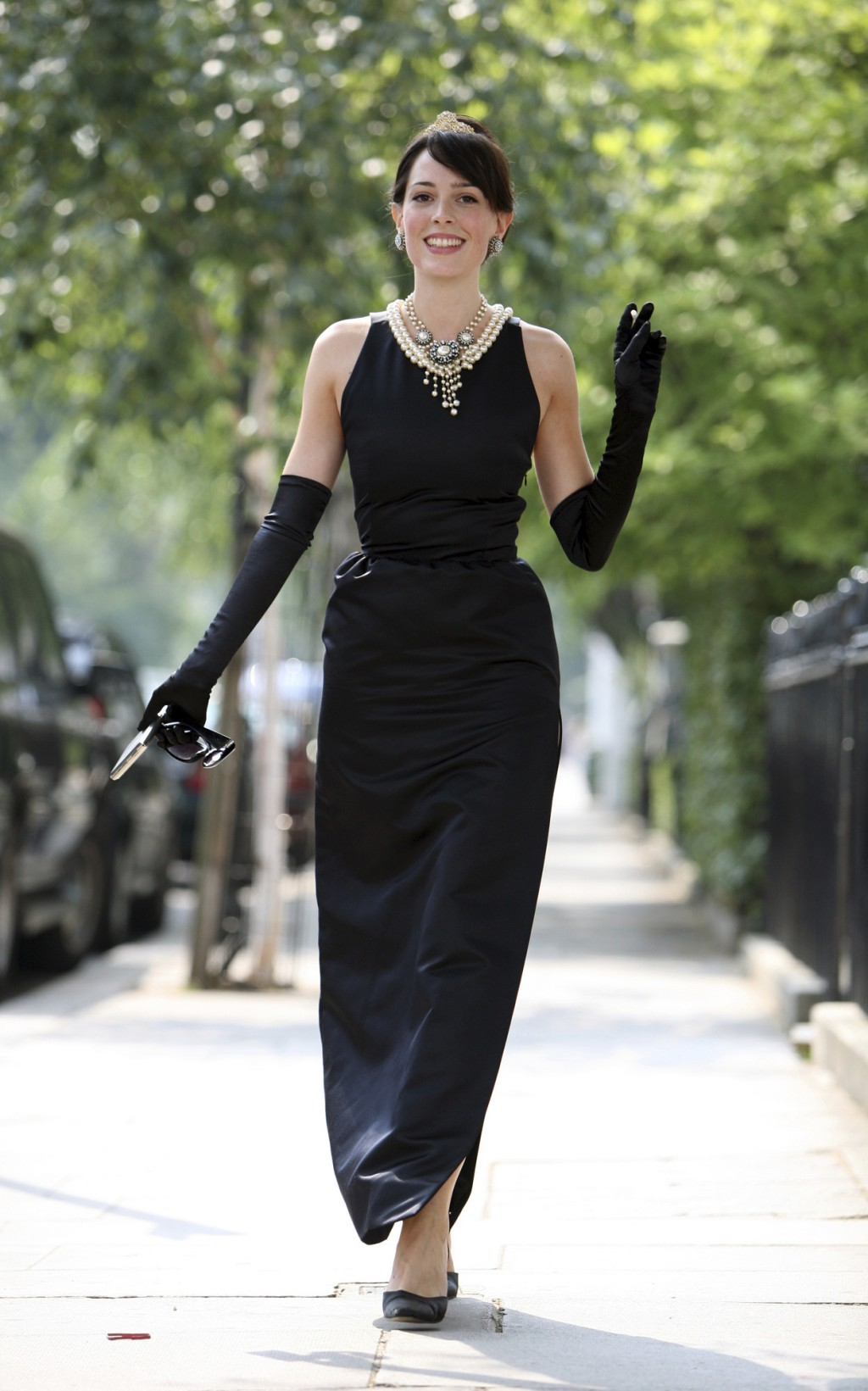 FILE- In this July 26, 2006, file photo, model Romilly Collins wears the black Givenchy dress made for actress Audrey Hepburn in the classic 1961 film
