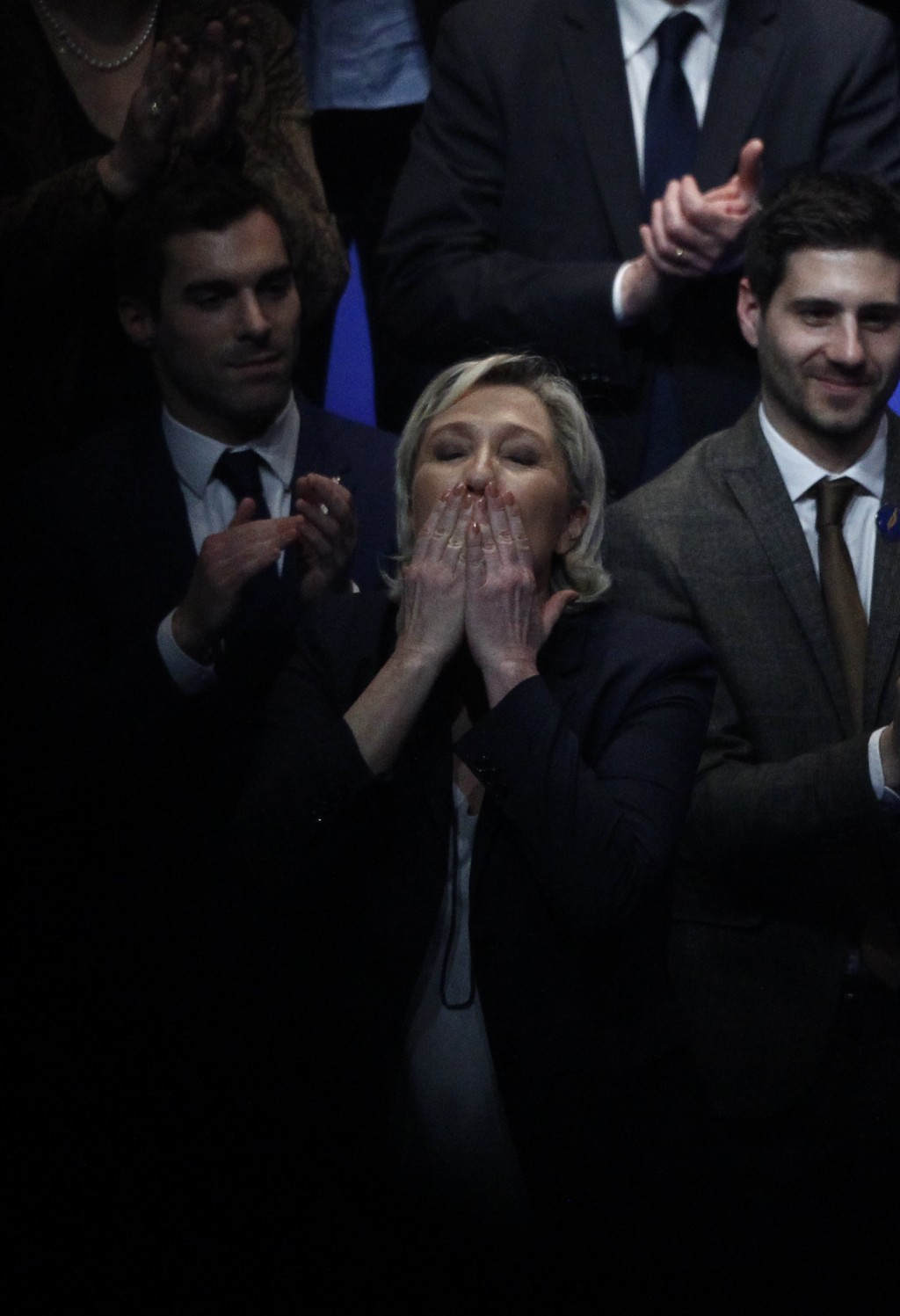 French far right leader Marine Le Pen reacts after her speech during the weekend's party congress in Lille, northern France, Sunday, March. 11, 2018.