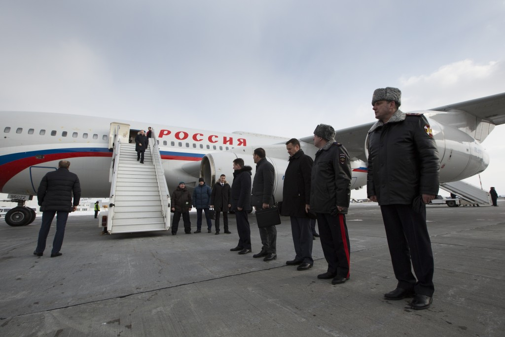 In this photo taken on Tuesday, March 6, 2018, Russian President Vladimir Putin, center top, steps out of a plane shortly upon his arrival to Yekateri
