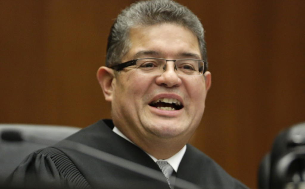 FILE - In this Nov. 25, 2013 file photo, Chief U.S. District Judge Ruben Castillo speaks from the benchin Chicago. Castillo is slated to issue a firs