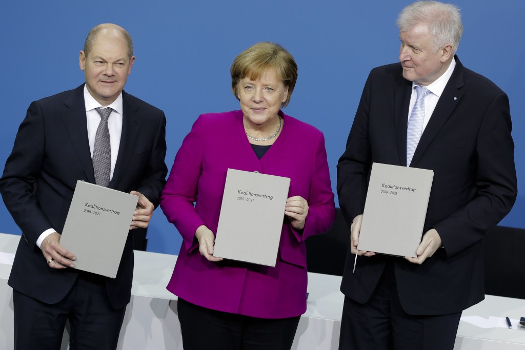 From left, Olaf Scholz, acting chairman of the German Social Democratic Party (SPD), German Chancellor and chairwomen of the German Christian Democrat