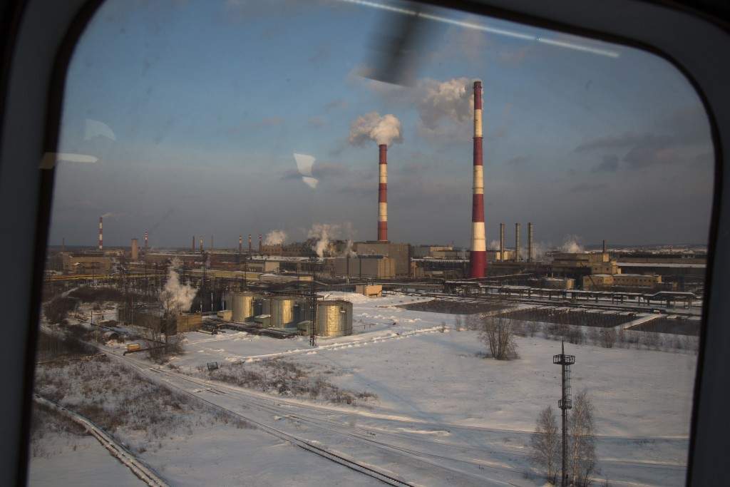 In this photo taken on Tuesday, March 6, 2018, A view of the Uralvagonzavod factory from a helicopter escorting another one that carries Russian Presi