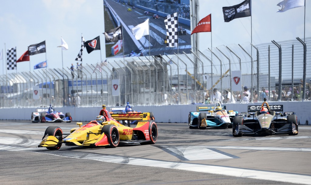 Ryan Hunter-Reay (28) and James Hinchcliffe (5) come into Turn 1 at the start of the IndyCar Firestone Grand Prix of St. Petersburg, Sunday, March 11,