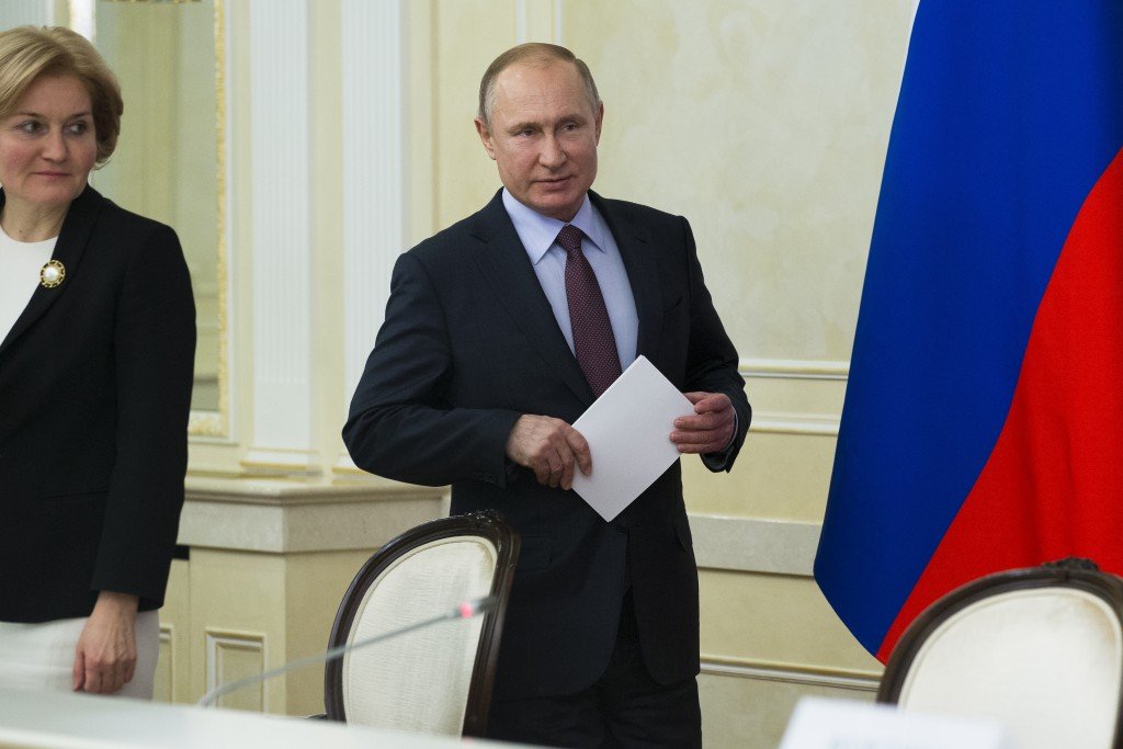 In this photo taken on Tuesday, March 6, 2018, Russian President Vladimir Putin arrives to attend a a meeting with top officials as Deputy Prime Minis