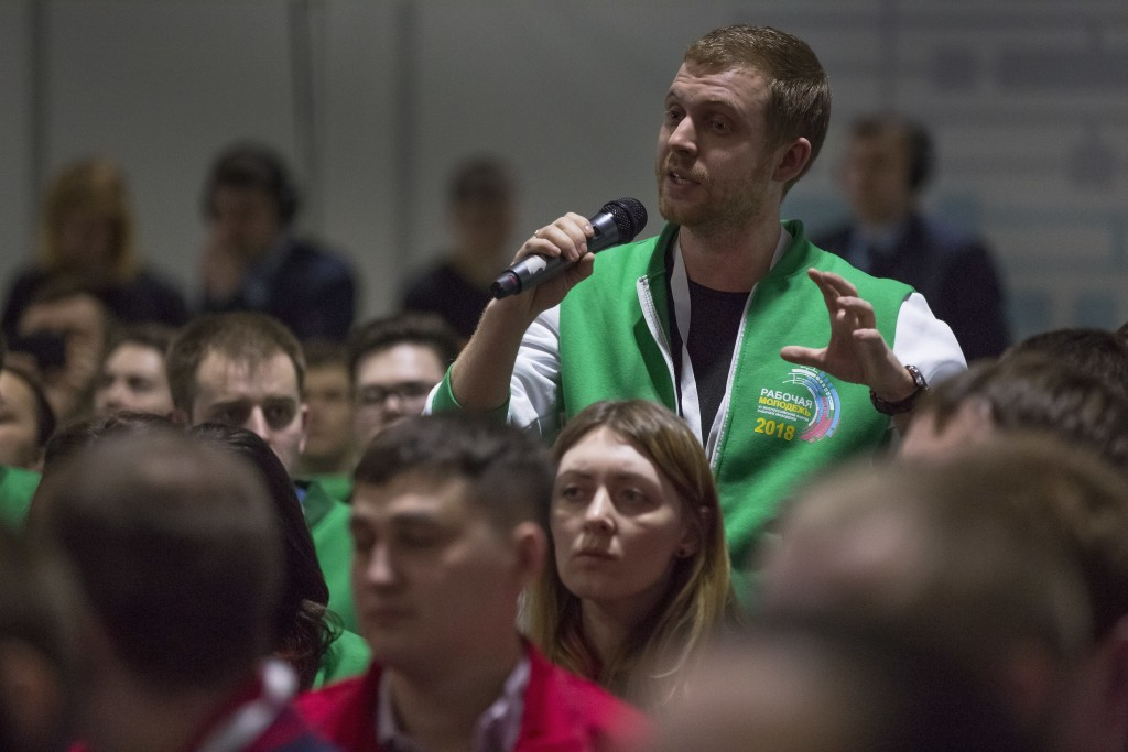 In this photo taken on Tuesday, March 6, 2018, a worker asks a question to Russian President Vladimir Putin during a forum on young workers at the Ura