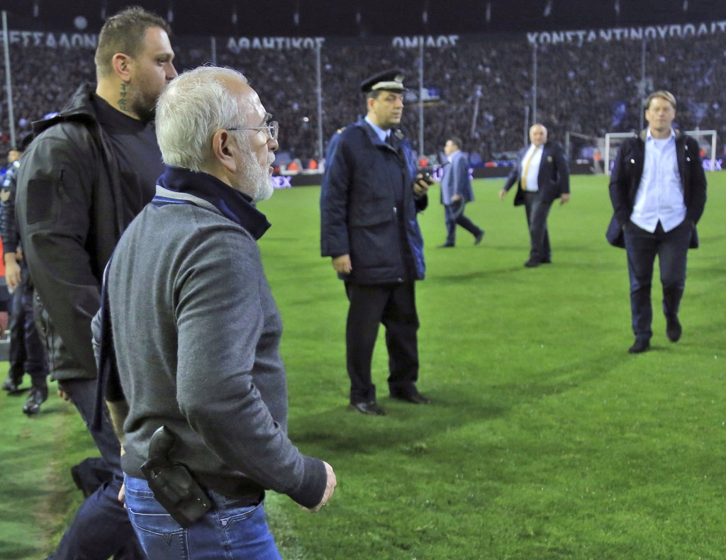 PAOK owner, businessman Ivan Savvidis invades into the pitch during the Greek League soccer match between PAOK and AEK Athens in the northern Greek ci