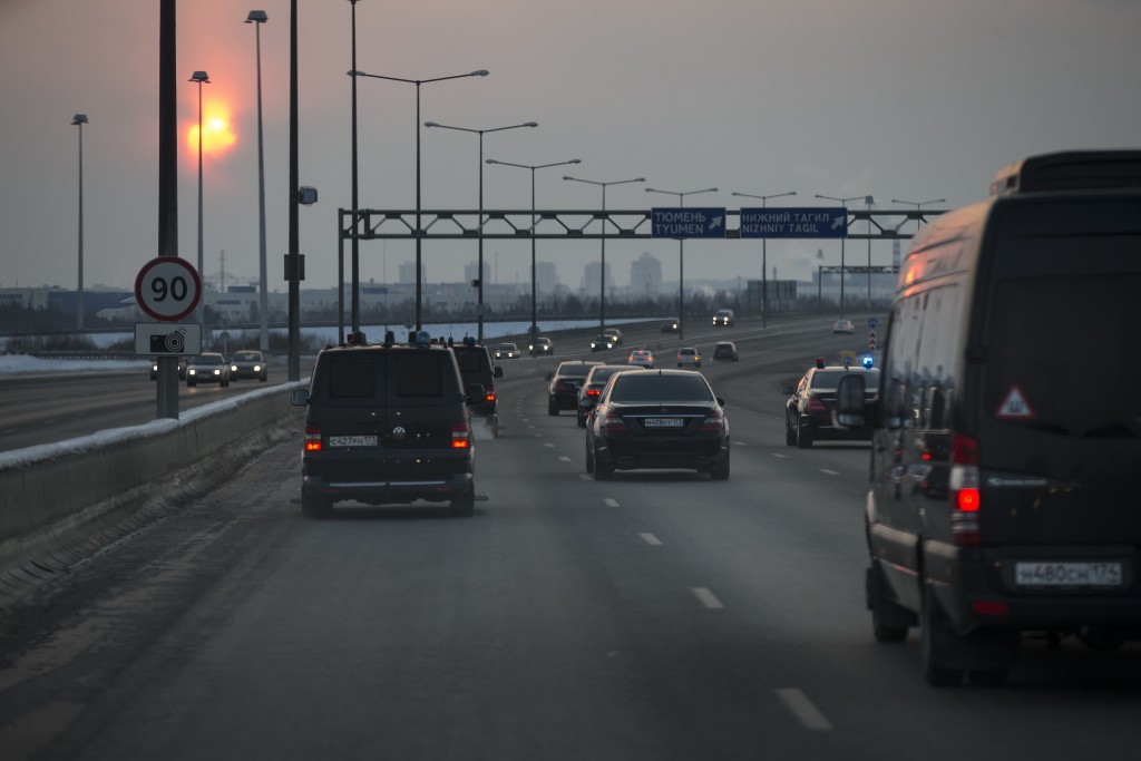 In this photo taken on Tuesday, March 6, 2018, The motorcade carrying Russian President Vladimir Putin speeds up along a highway from the airport Kolt