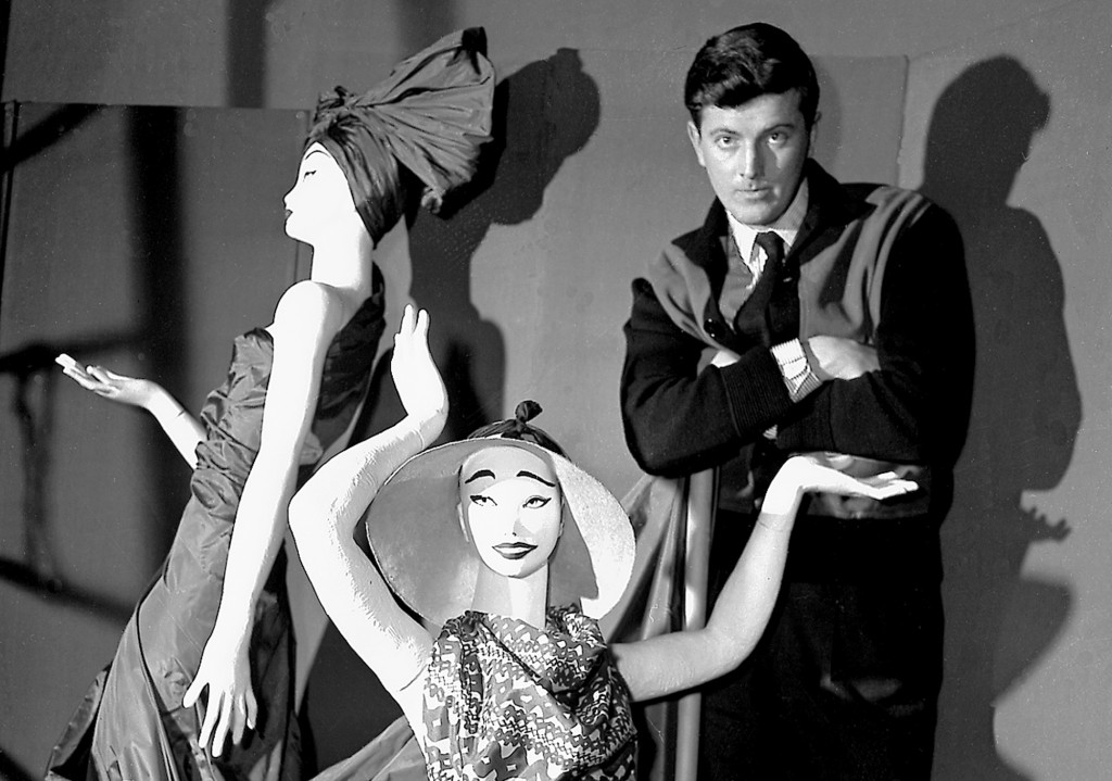 FILE - In this Feb.1 1952 file photo, French fashion designer Hubert de Givenchy poses with mannequins in his shop in Paris. French couturier Hubert d