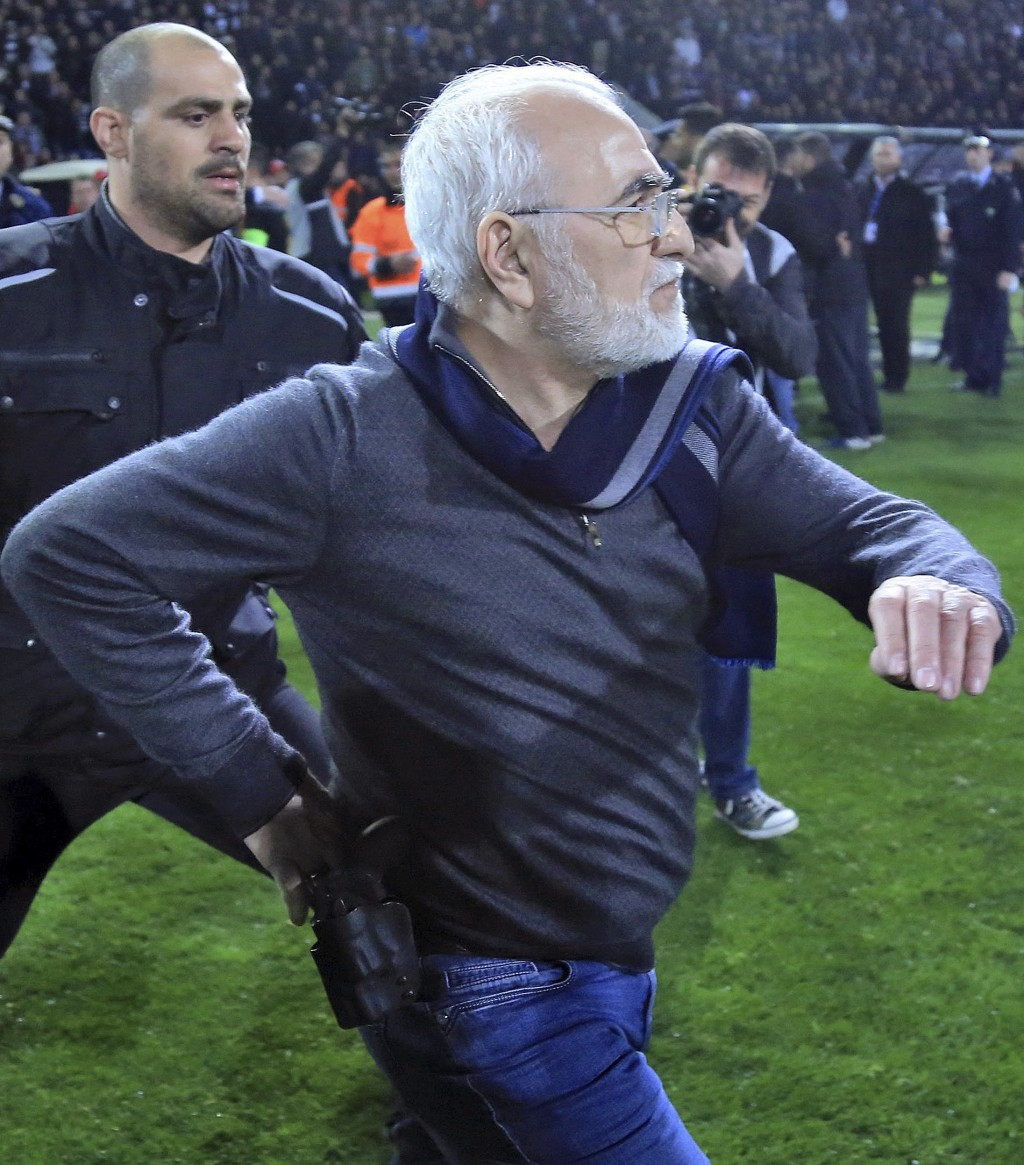 PAOK owner, businessman Ivan Savvidis invades into the pitch during a Greek League soccer match between PAOK and AEK Athens in the northern Greek city