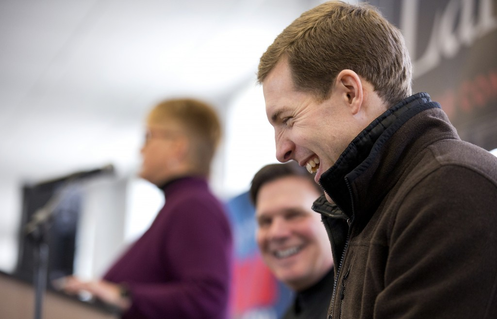 Democratic candidate Conor Lamb laughs during a rally with the United Mine Workers of America, Sunday, March 11, 2018, at the Greene County Fairground