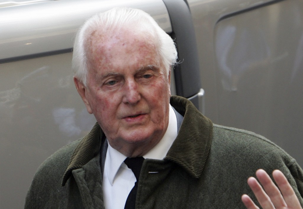 FILE - In this June 4 2007 file photo, French fashion designer Hubert de Givenchy leaves the Saint-Louis en l'Ile church in Paris. French couturier Hu