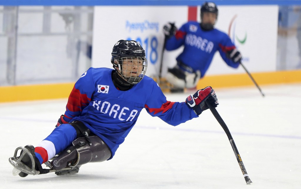 In this March 8, 2018, photo, South Korean sledge ice hockey player Choi Kwang Hyouk plays on the ice during a training session prior to the Pyeongcha...