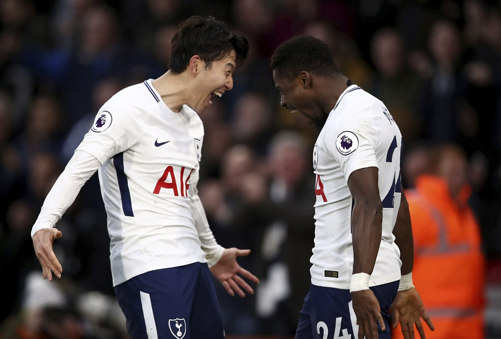 Tottenham Hotspur's Serge Aurier, right, celebrates scoring his side's fourth goal against AFC Bournemouth with teammate Son Heung-Min, during their E
