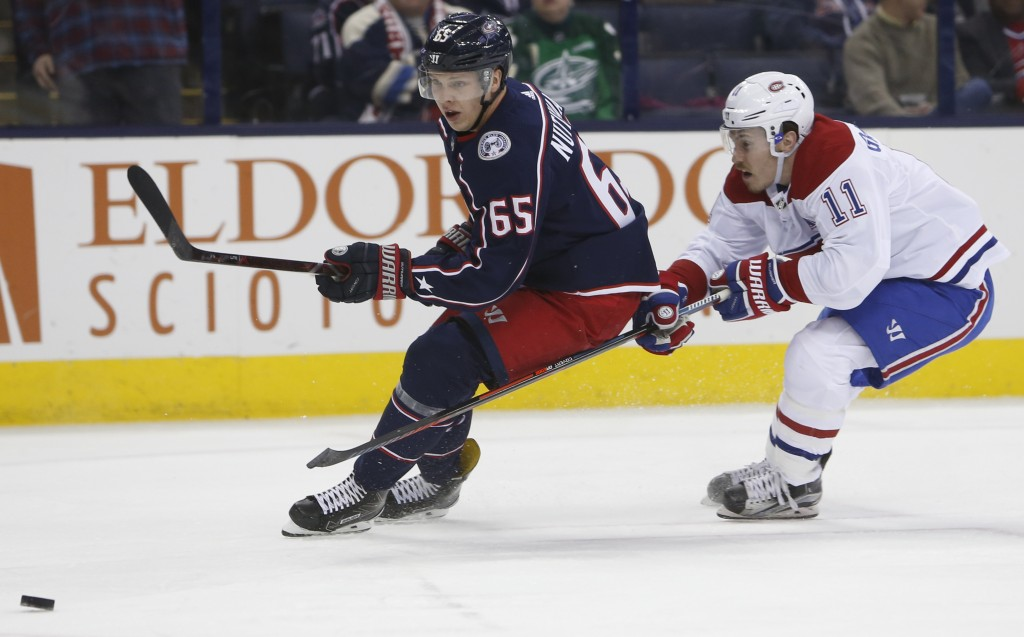 Montreal Canadiens' Brendan Gallagher, right, chases Columbus Blue Jackets' Markus Nutivaara, of Finland, during the first period of an NHL hockey gam