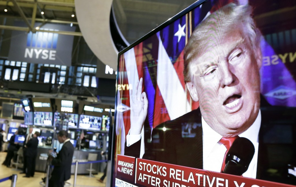 FILE- In this Nov. 9, 2016, file photo an image of President-elect Donald Trump appears on a television screen on the floor of the New York Stock Exch