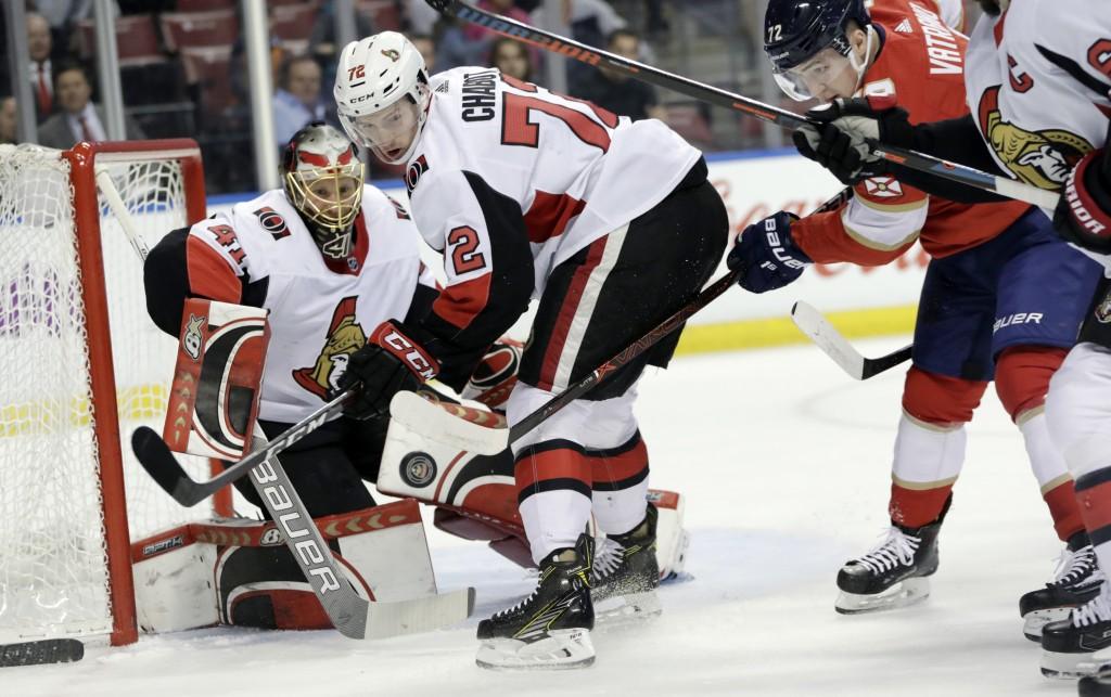 Florida Panthers' Frank Vatrano, right, attempts a shot on goal as Ottawa Senators goaltender Craig Anderson makes a save as Senators' Thomas Chabot (