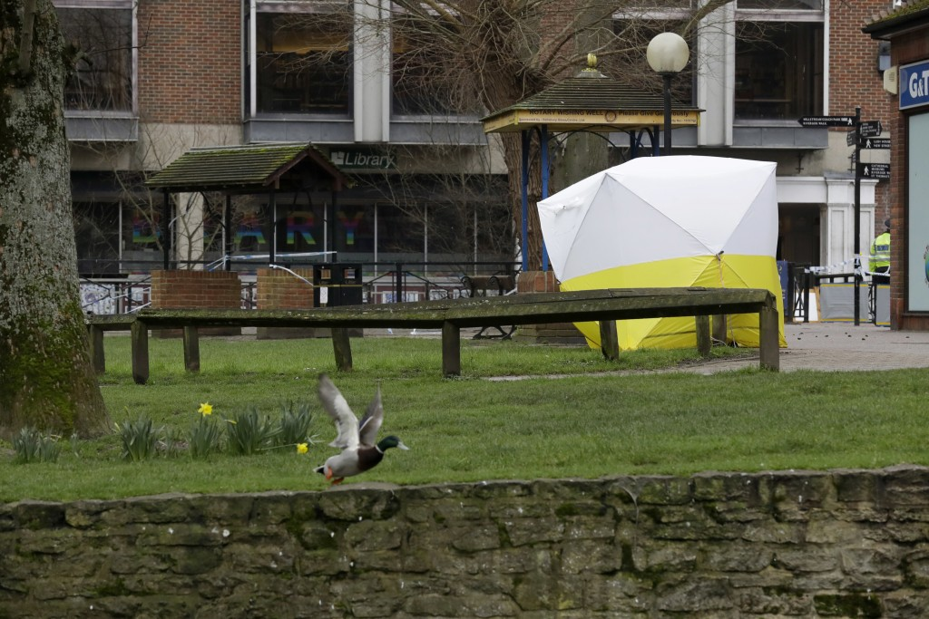 A police tent covers the area where former Russian double agent Sergei Skripal and his daughter were found critically ill following exposure to the Ru