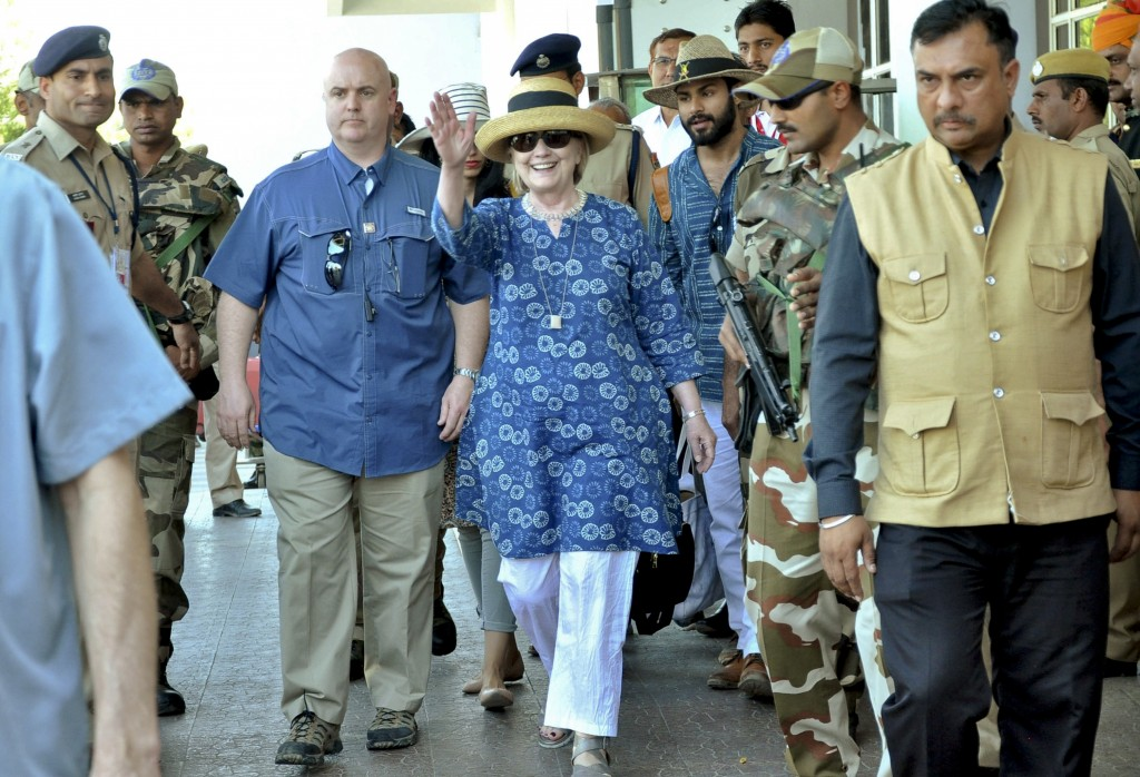 Former U.S. Secretary of State Hillary Clinton, center, waves as she comes out of the Jodhpur airport upoon her arrival in Jodhpur, Rajasthan state, I