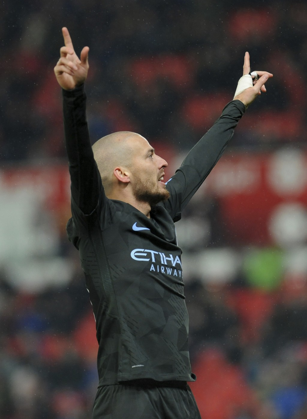 Manchester City's David Silva celebrates after scoring his second goal during the English Premier League soccer match between Stoke City and Mancheste