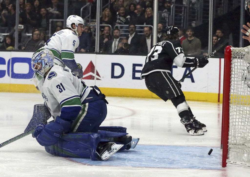 Los Angeles Kings right winger Dustin Brown (23) puts the puck past Vancouver Canucks goalie Anders Nilsson (31) for a goal in the second period of an